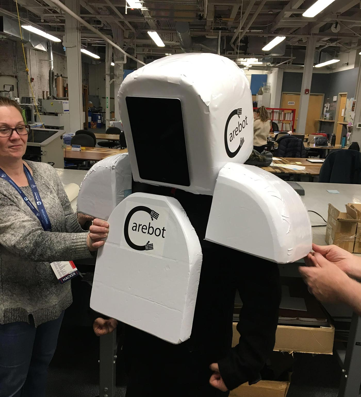 "The ""Reimagining Death"" team try on their ""Carebot"" prototype."